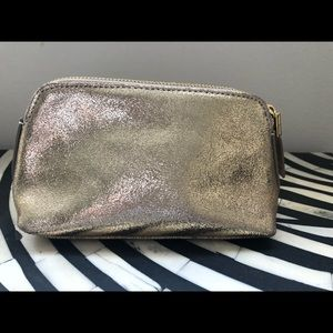 India Hicks gold cosmetic bag. Perfect condition.